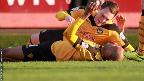 Chris Zebroski of Newport County celebrates scoring their first goal with Adam Chapman