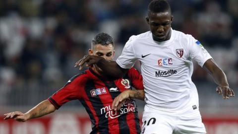 Modibo Maiga (right)