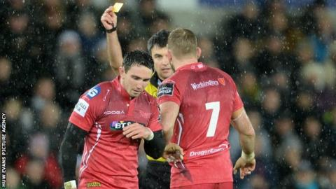 Kristian Phillips (L) is sent to the sin-bin by referee Marius Mitrea during the Scarlets' defeat by Ospreys