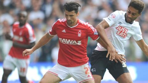 Nottingham Forest's Eric Lichaj (left) and Derby County's Ryan Shotton tussle for possession