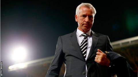 Alan Pardew of Newcastle United looks on prior to the Capital One Cup third round match between Crystal Palace and Newcastle United at Selhurst Park