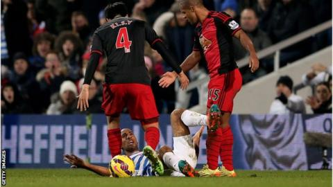 Karl Henry of QPR clashes with Swansea City pair Ki Sung-Yueng and Wayne Routledge