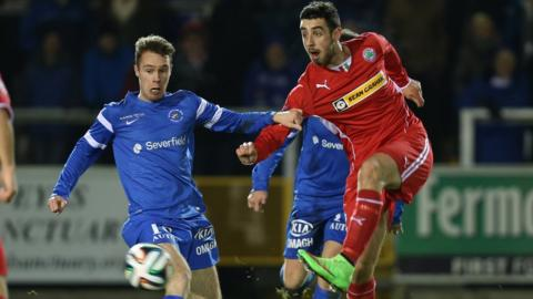 Ballinamallard's Colm McLoughlin can only watch as Cliftonville striker Joe Gormley fires in a shot during Tuesday night's clash at Ferney Park