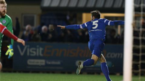 It's celebration time for Ballinamallard defender Mark Stafford after he scores the opener in the 1-1 draw with the Reds