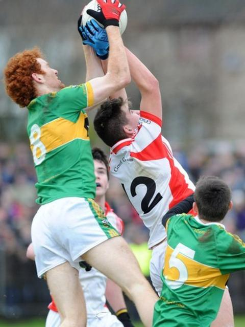 Watty Graham's Conor Glass battles for a high ball with Brian Lake of Southern Gaels