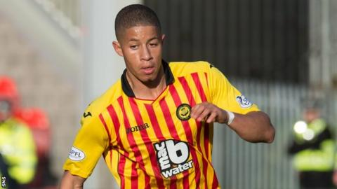 Jake Carroll in action for Partick Thistle