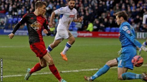 Midfielder Tom Carroll is on a season-long loan from Tottenham at Swansea