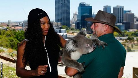 Serena Williams meets Sunshine the koala and handler Steve Gillam from Caversham Wildlife Park at the Hopman Cup