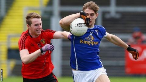 Paul Devine and Killian Clarke contend for possession as Cavan beat Down at Pairc Esler