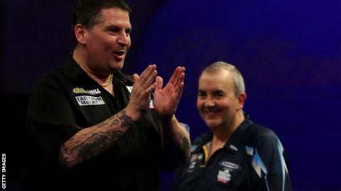 Phil Taylor watches on as Gary Anderson celebrates