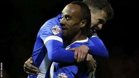 Chris O'Grady celebrates his first goal for Brighton with Solly March