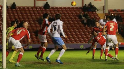 Marcus Tudgay heads home Walsall's clinching second goal at Bescot