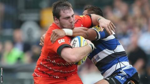 Fraser Balmain (left) is tackled by Bath's Alafoti Fa'osiliva