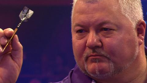 Darryl Fitton eliminates number two seed Alan 'Chuck' Norris in the second round at the BDO World Darts Championship