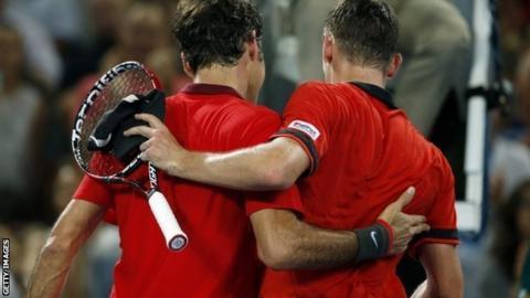 Roger Federer and John Millman