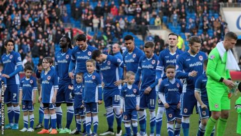 The Cardiff City players lined up in blue at home for the first time since 2012
