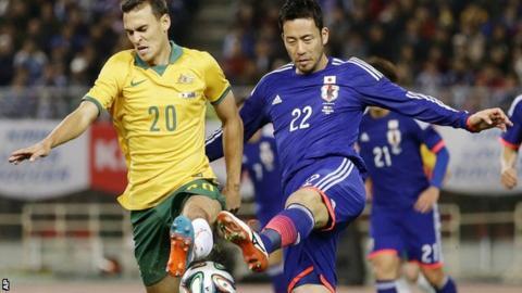 Maya Yoshida (right) in action for Japan against Australia