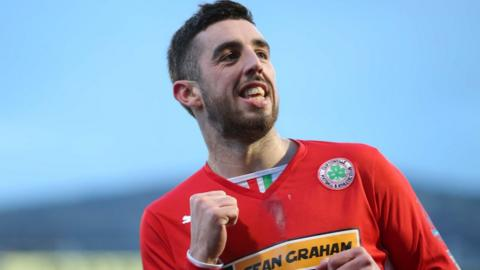 A familiar sight in local football - Cliftonville striker Joe Gormley celebrating a goal, this time one of two strikes against Ards Rangers in a 6-0 rout