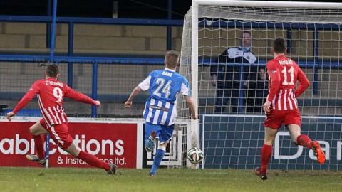 Warrenpoint striker Daniel Hughes fires in the opener in an impressive 3-1 victory over the Bannsiders