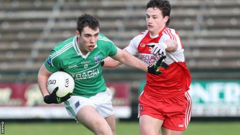 Fermanagh's Ryan Jones is challenged by Derry opponent Kevin Johnston