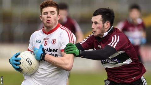 Tyrone midfielder Cathal McShane is tackled by Ciaran McCoey of St Mary's