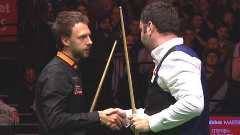 Judd Trump shakes hands with Stephen Maguire