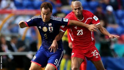 Shinji Okazaki (left) in action for Japan in the Asian Cup against Palestine