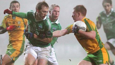 Fermanagh's Tommy McElroy blocks the path of Donegal opponent Shane McLoughln