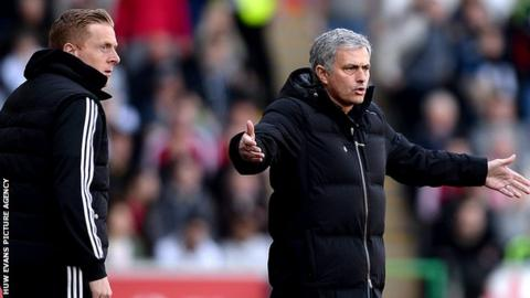 Garry Monk (L) and Jose Mourinho