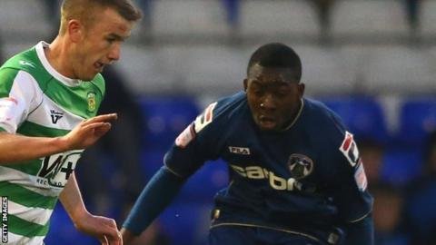 Glenn Belezika (right) in action for Oldham Athletic against Yeovil Town in 2013