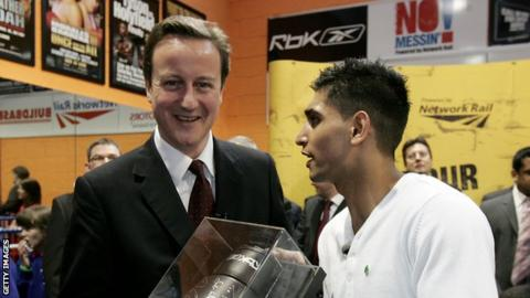 David Cameron (left) and Amir Khan