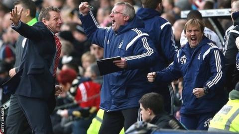 Stuart Pearce and the Nottingham Forest coaching staff celebrate the equaliser against Derby