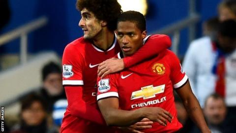 Marouane Fellaini and Antonio Valencia