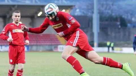 Joe Gormley put Cliftonville 2-1 ahead against Warrenpoint Town but the visitors equalised to secure a precious point in their fight to avoid relegation