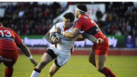 Jared Payne attempts to make ground for Ulster against European champions Toulon at the Mayol Stadium in southern France