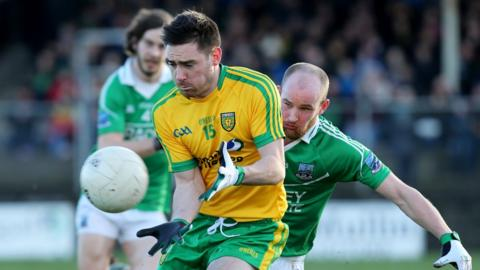Martin O'Reilly attempts to evade the attention of Conor Quigley during Fermanagh's 2-5 to 0-12 success over Donegal