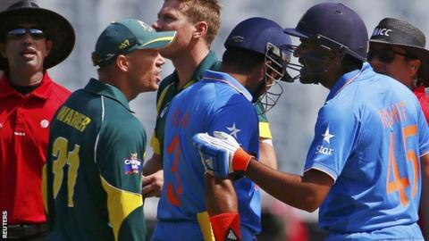 Australia batsman David Warner (left) got into a heated exchange with India batsman Rohit Sharma (right)
