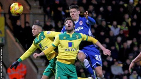 Cardiff's Alex Revell heads for goal against Norwich City