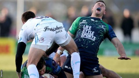 Robbie Henshaw grimaces after hurting his ankle in Connacht's defeat by Exeter