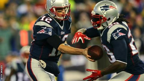 Tom Brady (12) of the New England Patriots hands the ball off to LeGarrette Blount