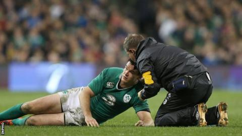 Jonathan Sexton gets treatment after being concussed in Ireland's game against Australia in late November
