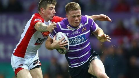 Joe Burgess (r) in action during last season's Grand Final