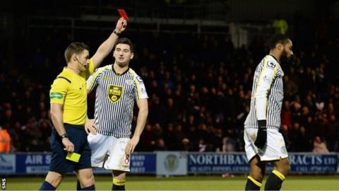Referee Steven McLean shows the red card to Yoann Arquin