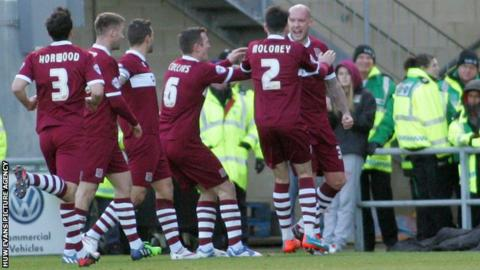 Ryan Creswell of Northampton (R) celebrates his goal