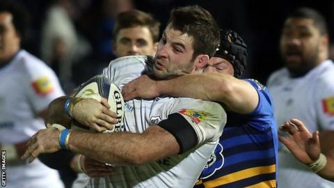 Johnnie Beattie is tackled during Castres' defeat by Harlequins