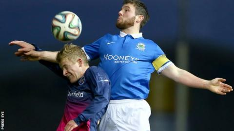 John Currie of Ballinamallard and Linfield's Jamie Mulgrew