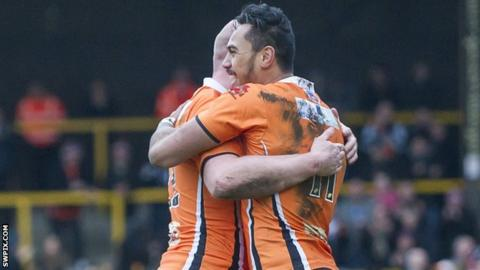 Denny Solomona and Liam Finn celebrate a Castleford try