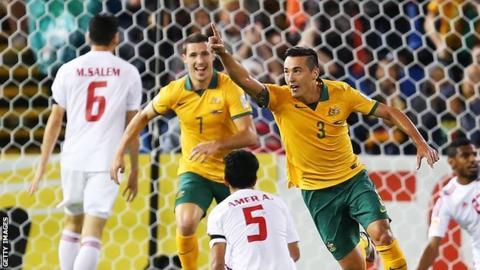 Jason Davidson (right) celebrates after scoring Australia's second goal