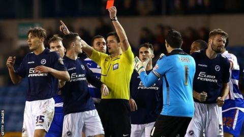 Millwall's Sid Nelson is shown a red card