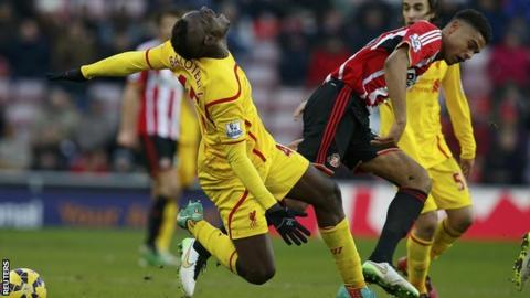 Mikael Mandron tangles with Mario Balotelli in Sunderland's 1-0 home defeat by Liverpool